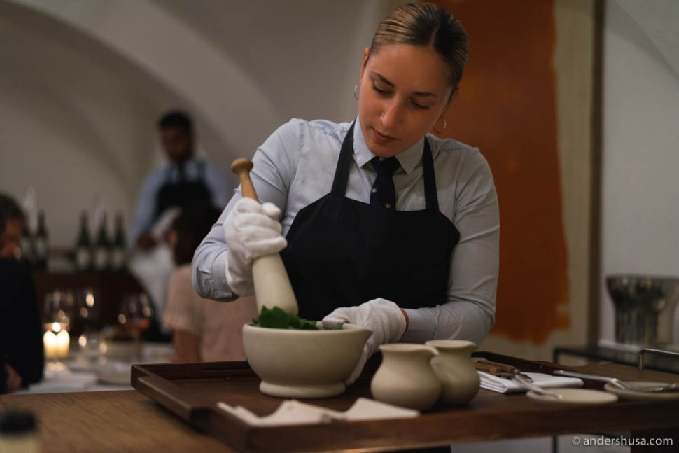 Preparing the dessert sauce with a pestel and mortar tableside