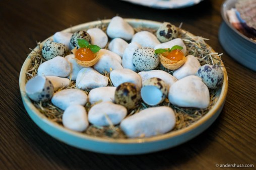 "Soy- and sugar kelp-cured quail eggs in potato ""nests"""