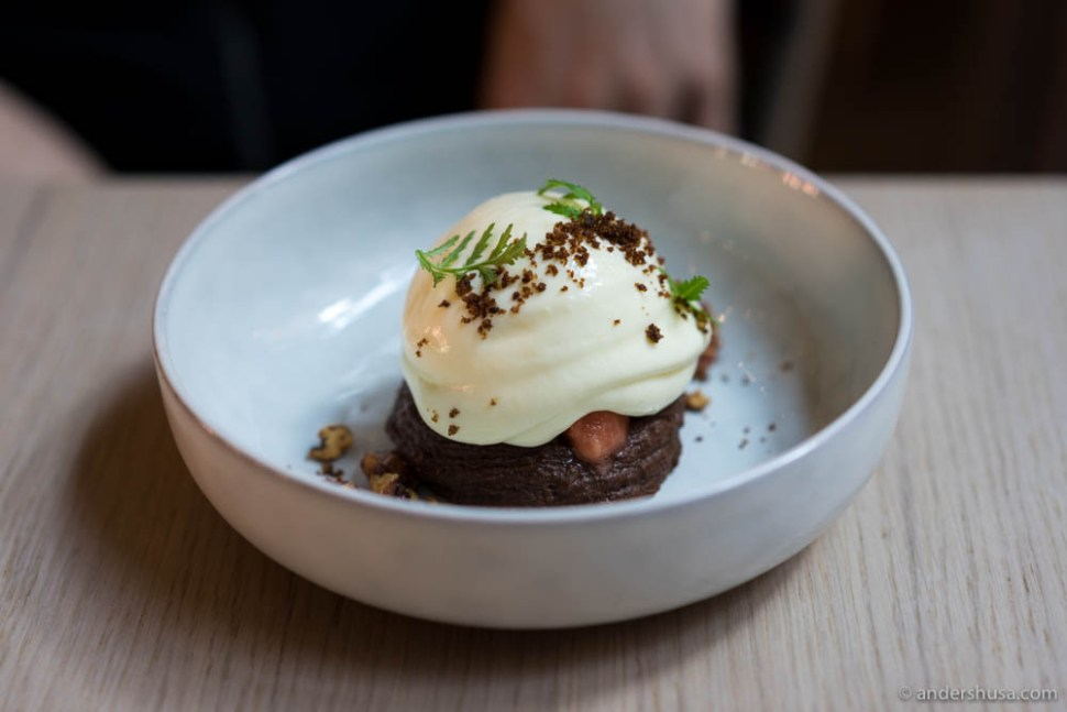 Classic Øllebrød with an Aamann's twist – brown butter, organic rye bread, chocolate, and dark beer from Harslev. Served with blood orange sorbet, candied walnuts, and buttermilk cream.
