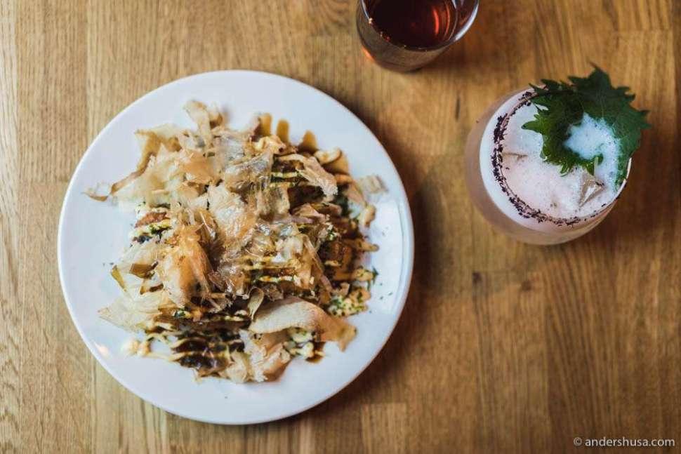 Pollock fritters in a takoyaki presentation with tonkatsu sauce, mayo, nori & bonito flakes