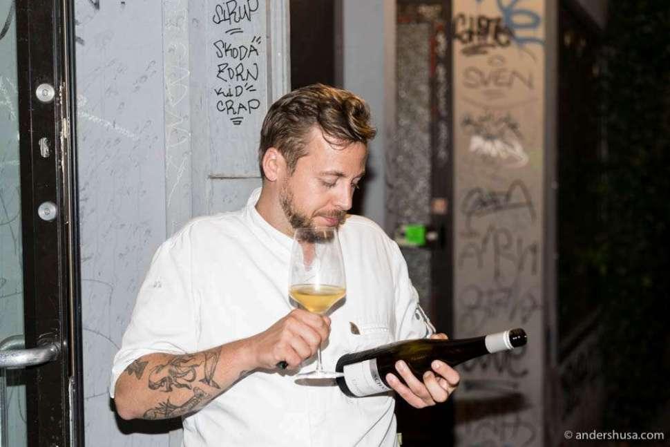 Fabio enjoys a glass of wine after service