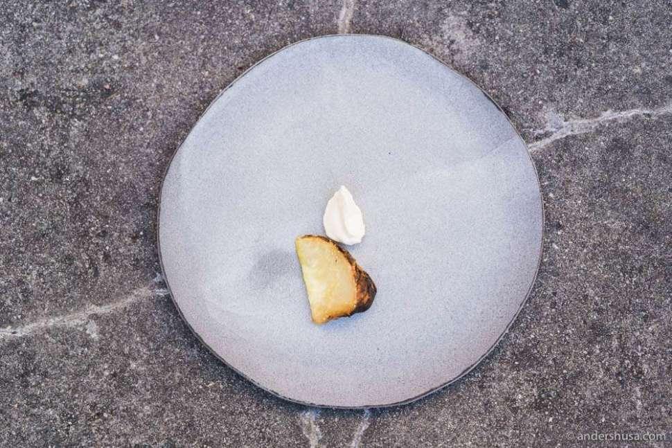 Umami-rich crust of baked celeriac with a fat heavy cream & blackcurrant wood oil