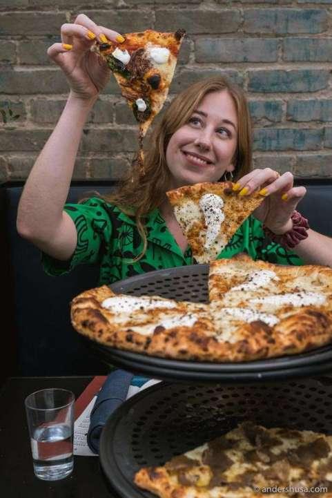 Kaitlin tries the short rib and cacio e pepe pizzas.