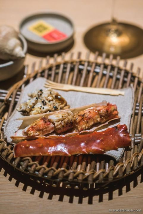 Barbecued king crab leg glazed in mushroom and ant sauce in the front.