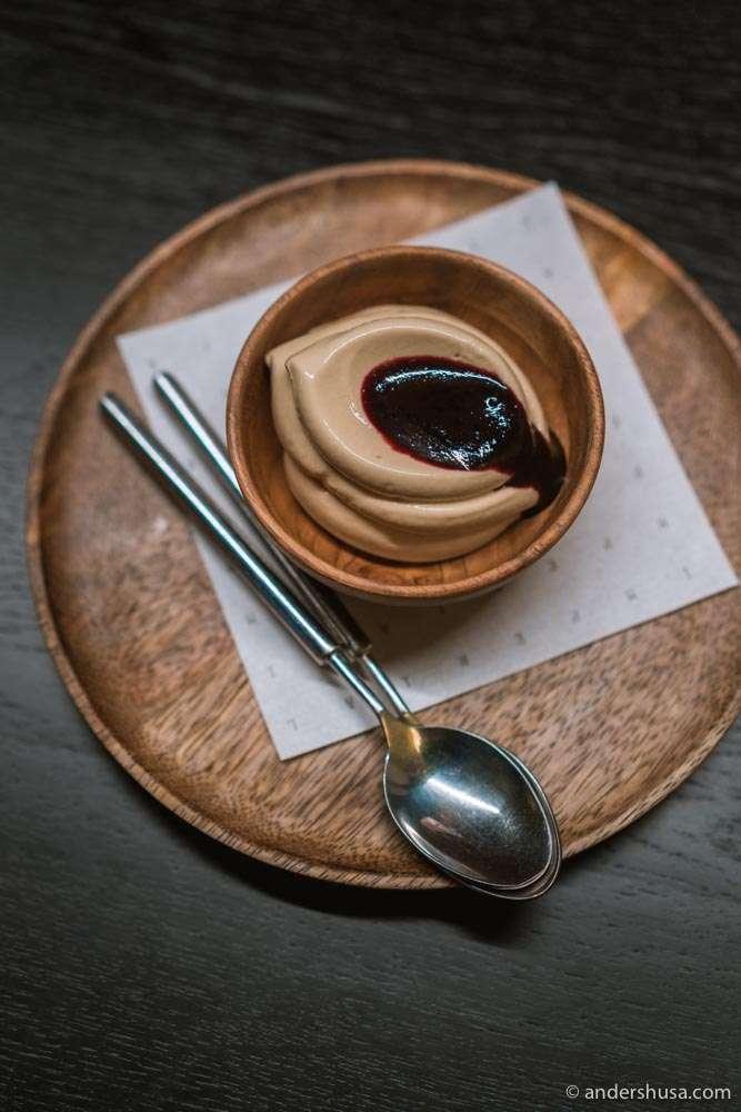 Licorice ice cream with blueberry syrup.