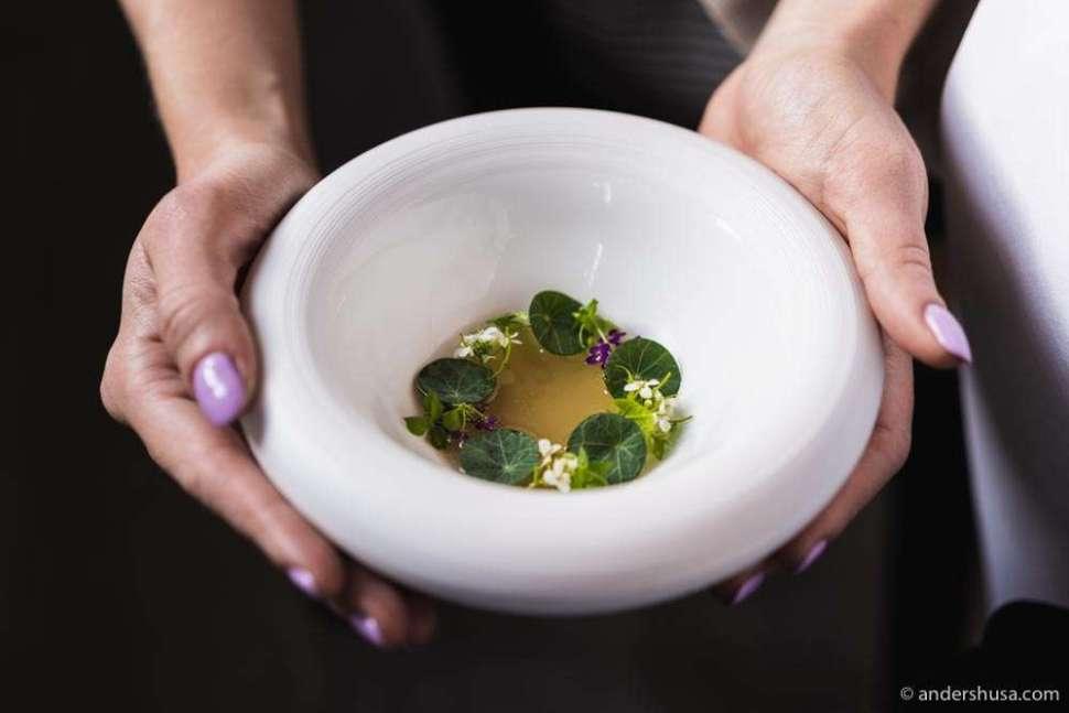 Danish blue mussel gel, garlic, tomato water, and nasturtiums