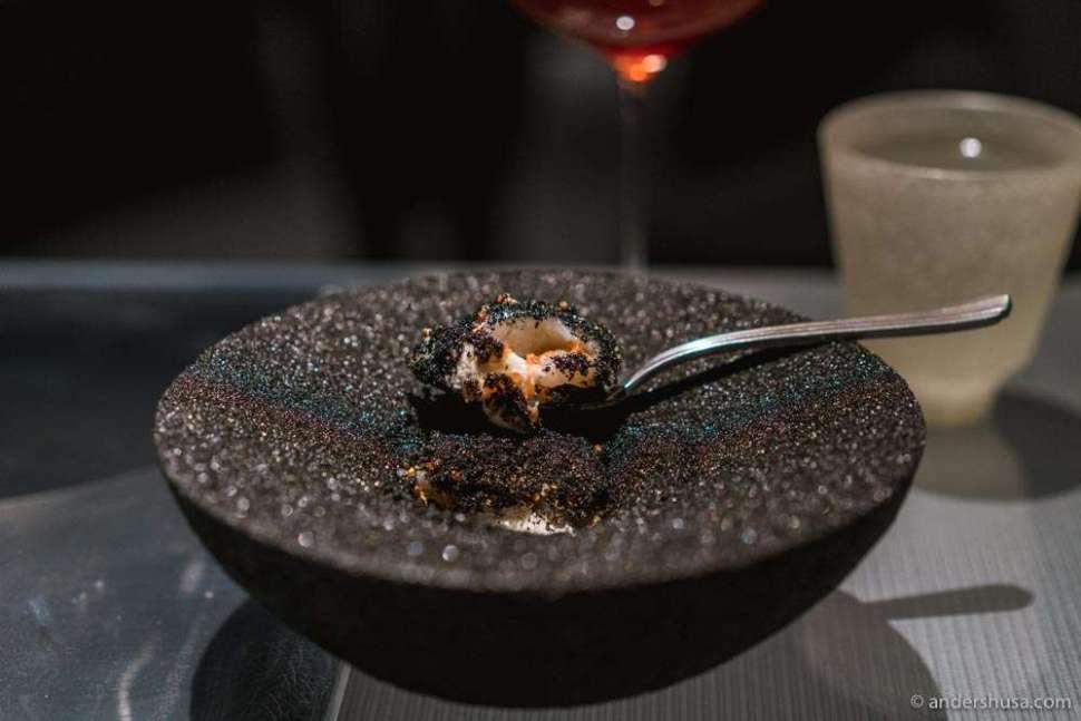 Raw Hokkaido scallops with umeboshi, burnt onion, smoked bone marrow, and puffed quinoa.