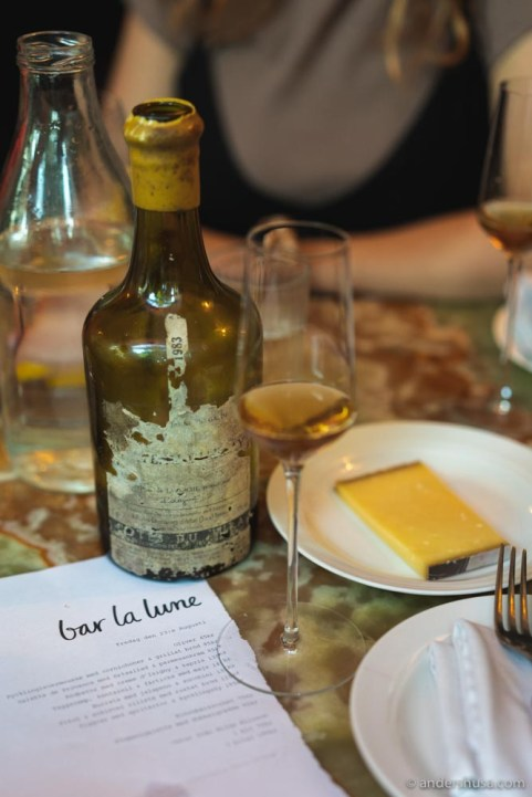 A vintage bottle of 1983 vin jaune paired with aged Comté cheese.