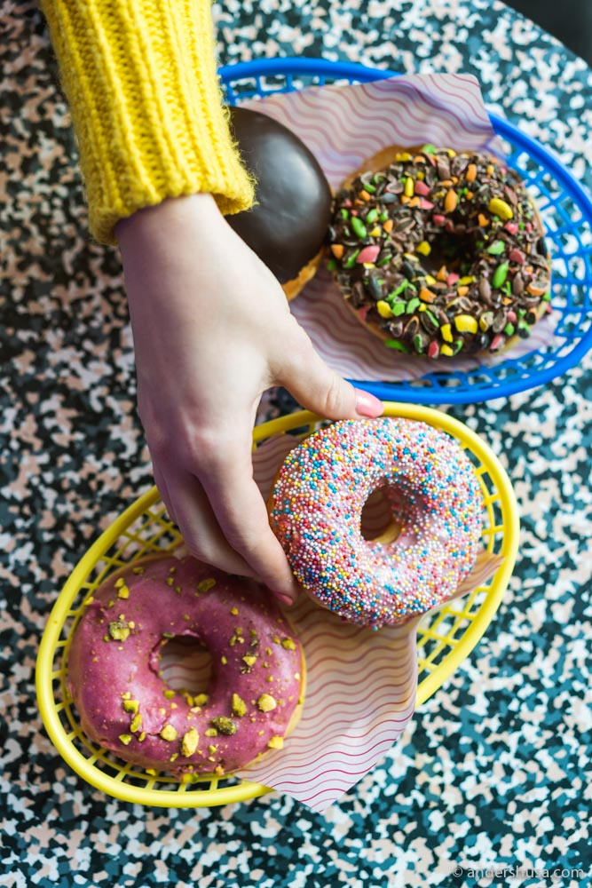 Kaitlin grabs for a strawberry sprinkle doughnut from Talormade.