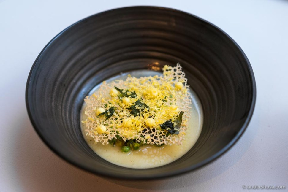 Green asparagus with koji, butter, and a crisp of cured egg yolk.
