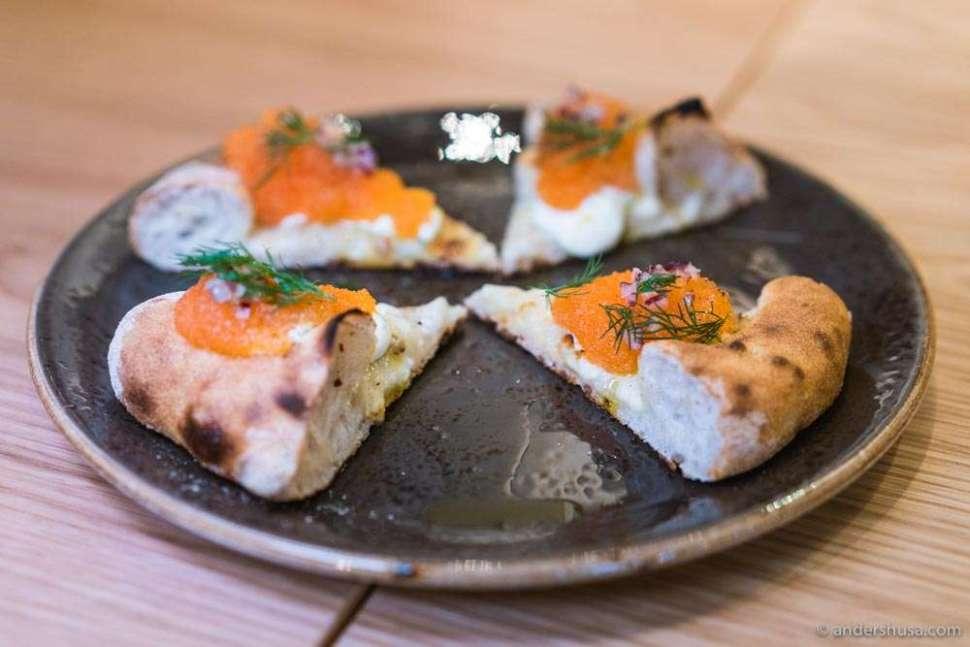 One Nordic pizza has løyrom, crème fraîche, and dill.