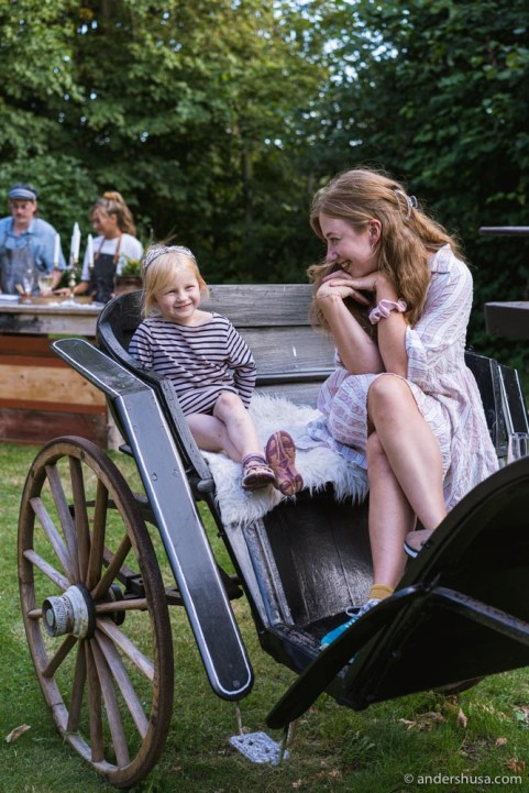 Marigel and Kaitlin sitting in the horse-drawn carriage.