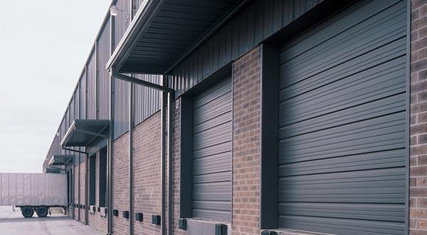 Commercial brown garage door in Hyrum, Utah