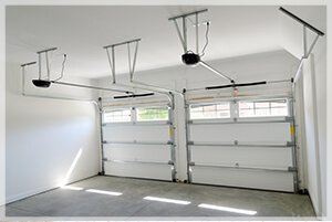the inside of a garage with a white garage door