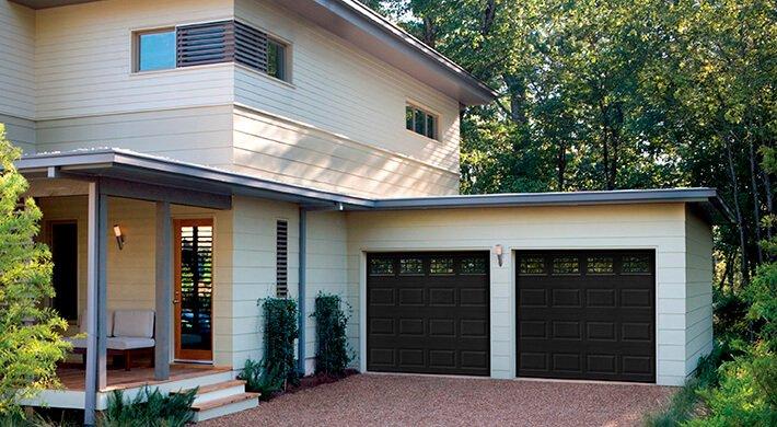 black Olympus residential garage doors in Logan, Utah