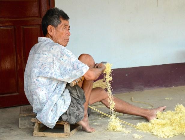 Threading bamboo.