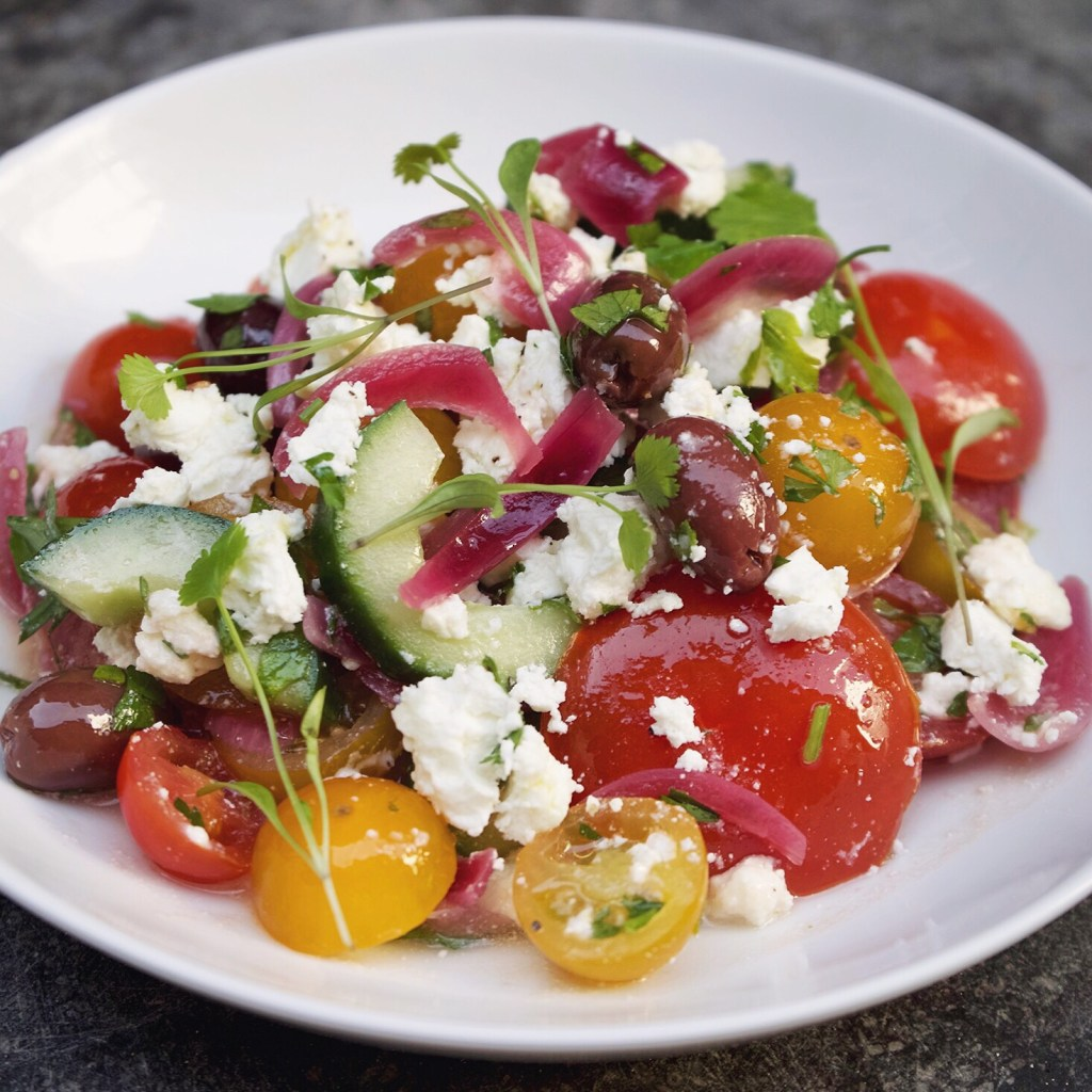 Greek Salad with mixed tomato, cucumber, kalamatas, sweet pickled onion, parsley & feta
