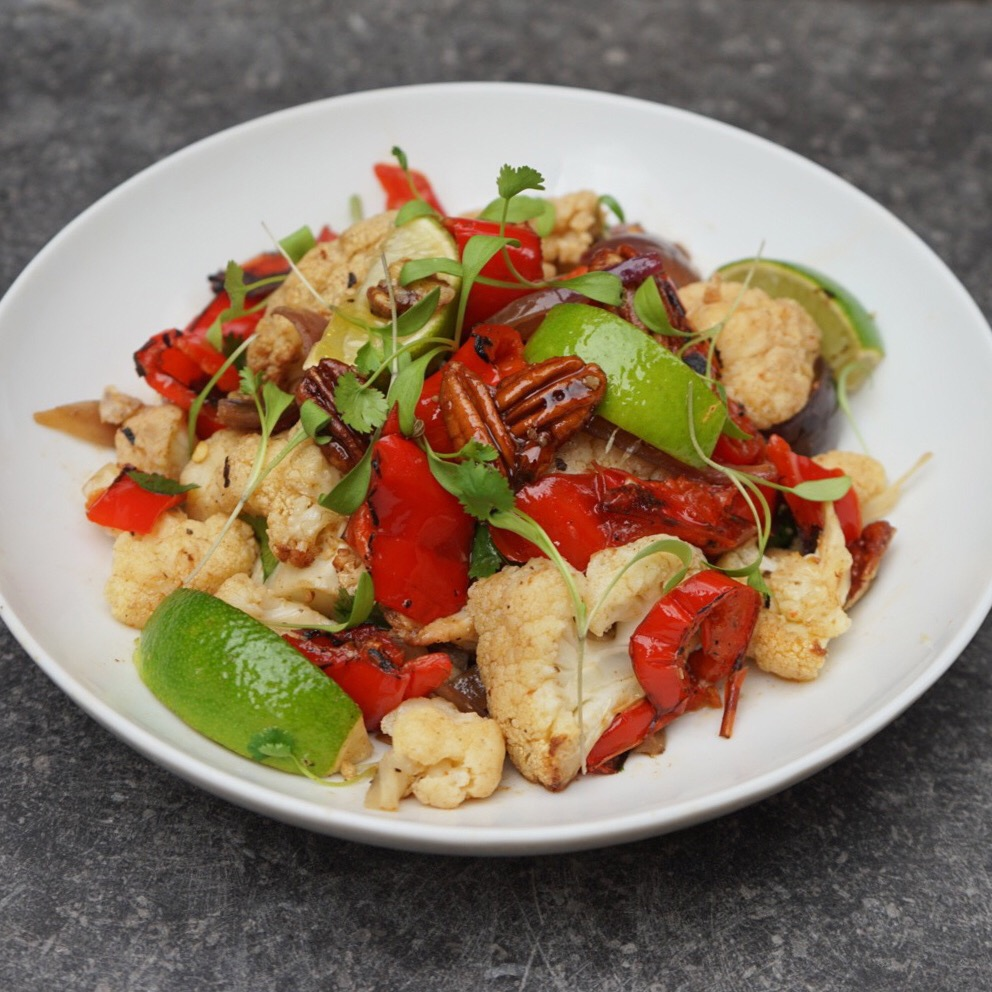 Cajun Cauliflower with Romano Peppers, Charred Red Onion, Candied Pecans, Chopped Coriander and Lime