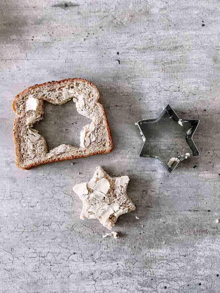 cut out the center of the bread with a cookie cutter shape