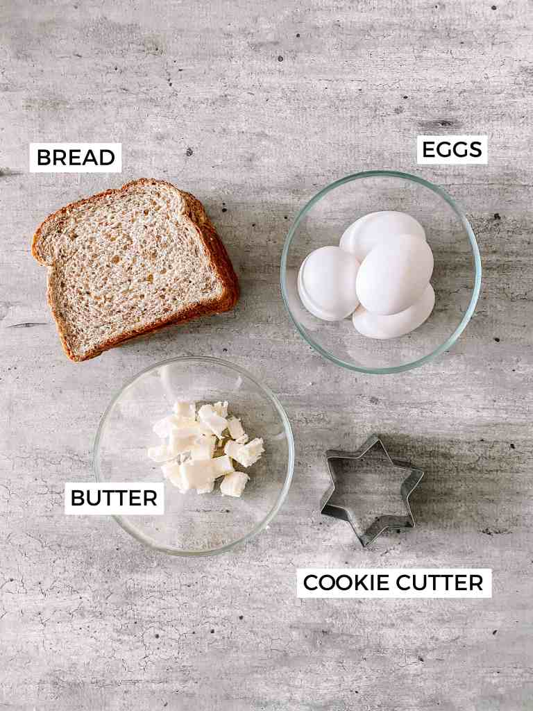 Baked Eggs In A Hole recipe ingredients including bread, eggs, butter and a cookie cutter