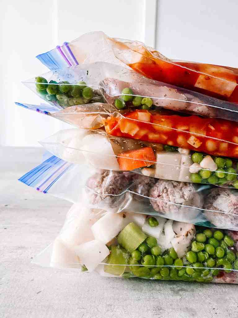 crockpot freezer meals recipes stacked in ziploc freezer bags