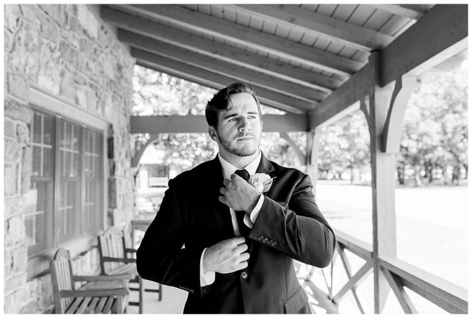 Black and white shot of groom getting ready at PostOak Lodge in Tulsa, OK| Tulsa Wedding Photographer| PostOak Lodge Wedding| Destination Wedding Photographer| Andi Bravo Photography