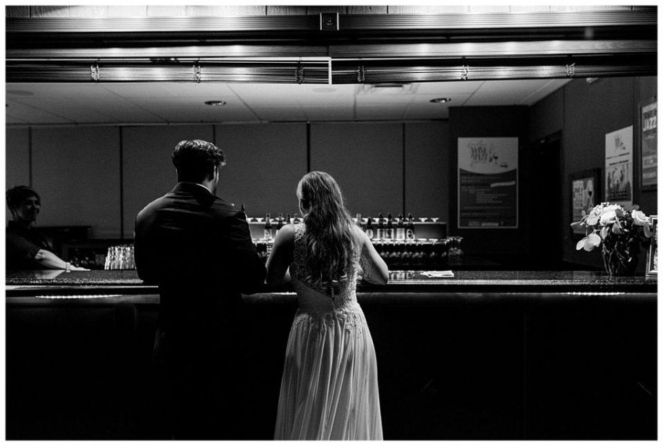 Black and white shot of bride and groom at the bar at PostOak Lodge in Tulsa, OK| Tulsa Wedding Photographer| PostOak Lodge Wedding| Destination Wedding Photographer| Andi Bravo Photography