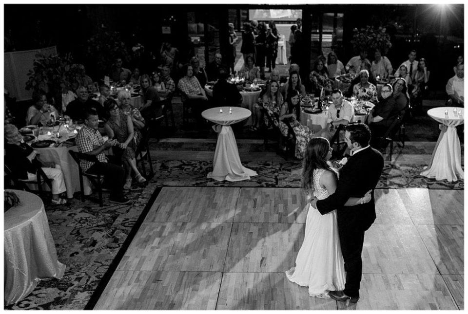 Black and white shot of bride and groom at first dance at PostOak Lodge in Tulsa, OK| Tulsa Wedding Photographer| PostOak Lodge Wedding| Destination Wedding Photographer| Andi Bravo Photography