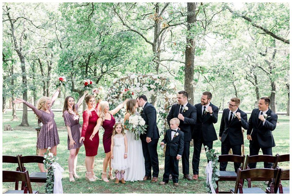 Bridal party celebrating at PostOak Lodge in Tulsa, OK| Tulsa Wedding Photographer| PostOak Lodge Wedding| Destination Wedding Photographer| Andi Bravo Photography