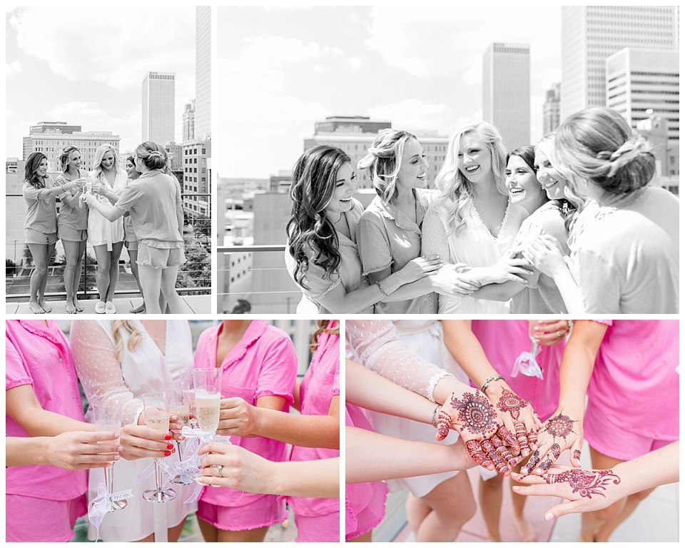 Black and white shots of bride and bridesmaids toasting on balcony with skyscrapers in the background| Bridesmaids henna tattoos| The Mayo Hotel| Wedding Part Two| Tulsa Wedding Photographer| Destination Wedding Photographer| Andi Bravo Photography
