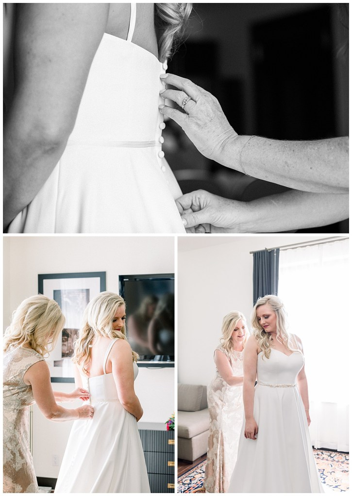 Black and white of mother of the bride's hands buttoning the back of bride's gown| mother of the bride| The Mayo Hotel Wedding| Tulsa wedding photographer| Andi Bravo Photography