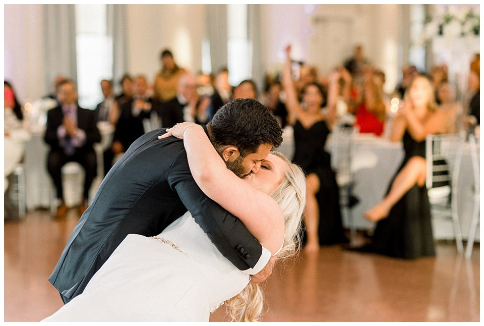 Groom leads bride over on the dance floor for kiss| The Mayo Hotel wedding| Tulsa wedding photographer| Andi Bravo Photography