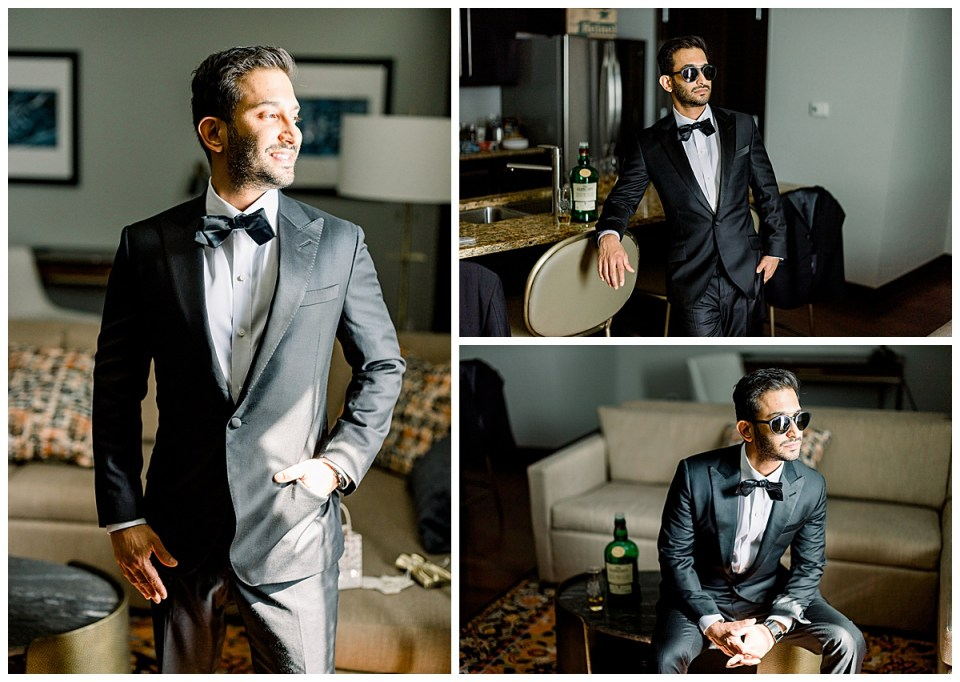 Groom looking dapper wearing shades next to fancy bottle of liquor| The Mayo Hotel Wedding| Tulsa wedding photographer| Andi Bravo Photography