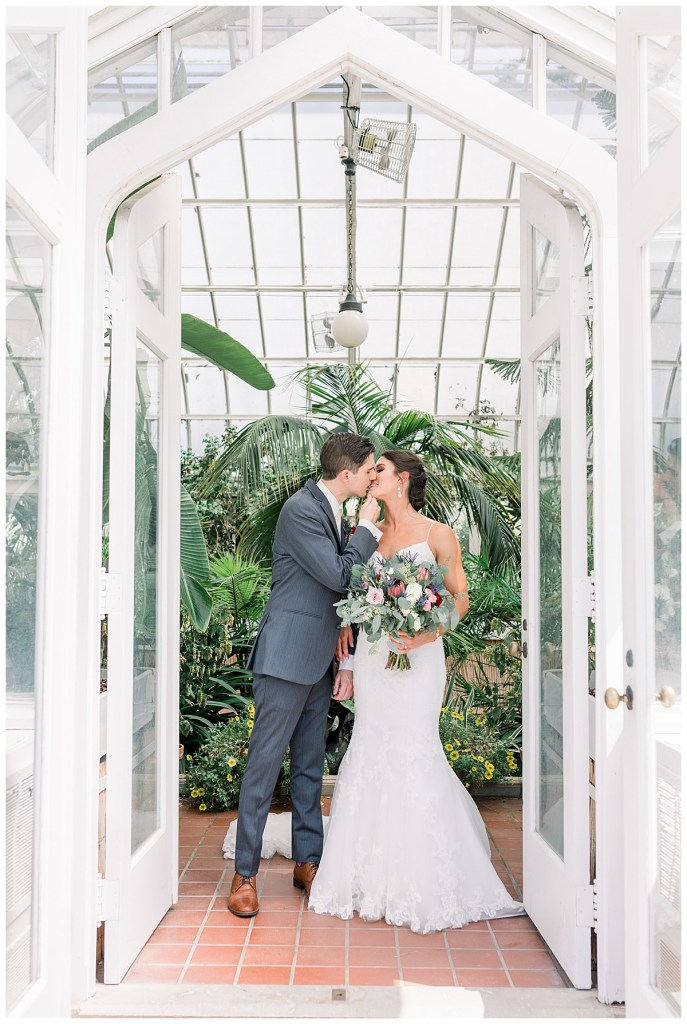 Bride and groom standing in white doorway of greenhouse| Tulsa wedding venue| Unique wedding location| Tulsa wedding photographer| Andi Bravo Photography