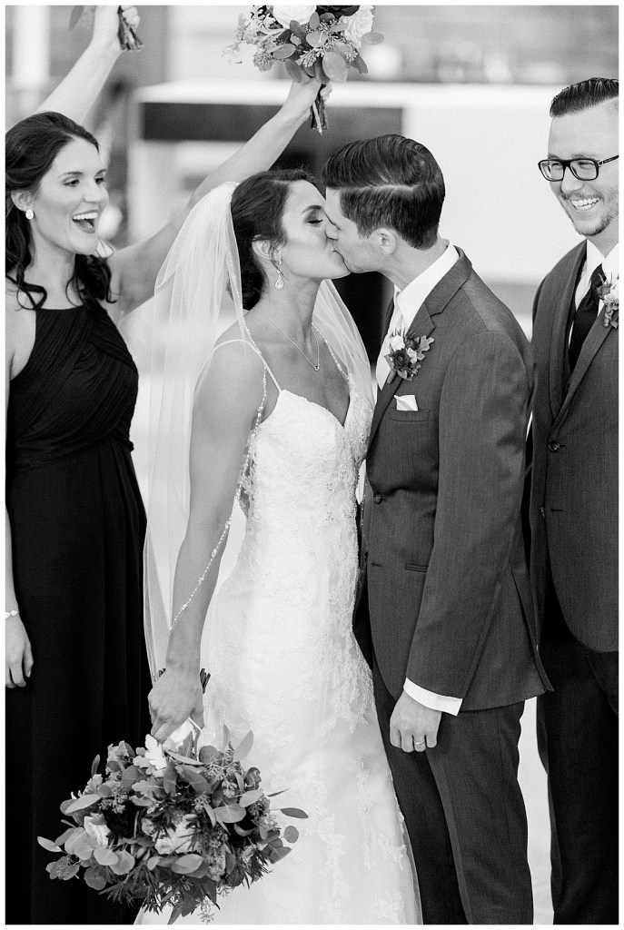 Black and white wedding first kiss| Andi Bravo Photography