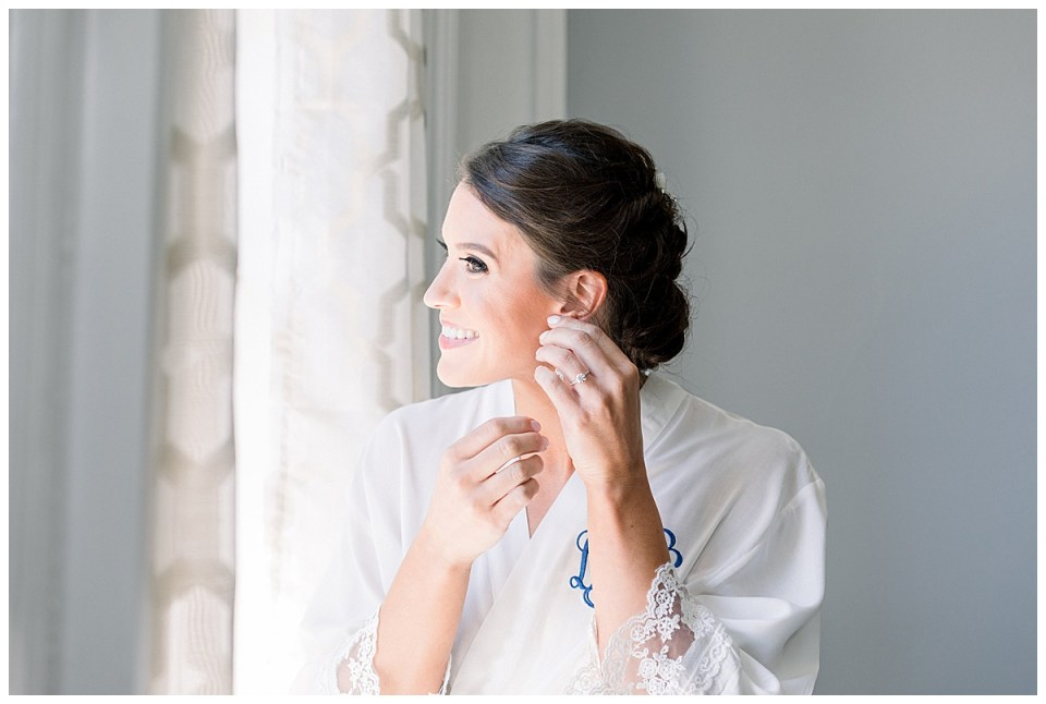 Bride putting on earrings getting ready shot| Tulsa wedding| Tulsa wedding photographer| Andi Bravo Photography