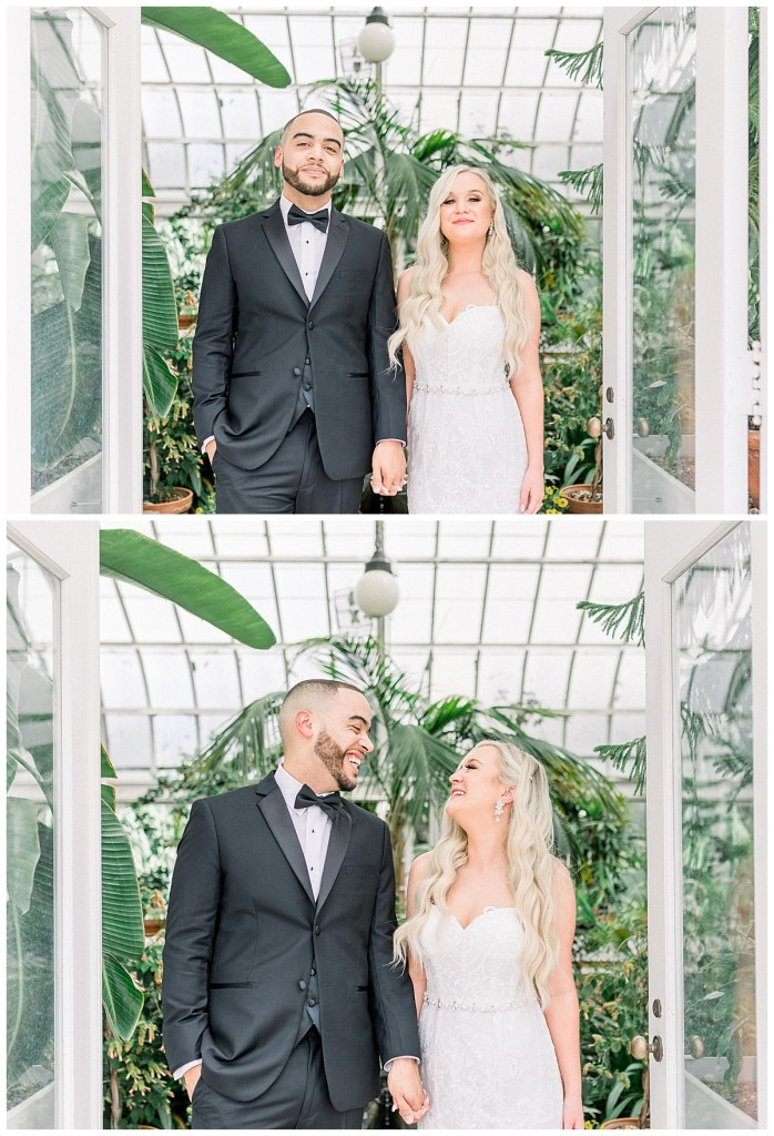 Bride and groom holding hands and smiling in doorway of greenhouse| Greenhouse wedding portrait| Tulsa wedding venue| Tulsa wedding photographer| Andi Bravo Photography