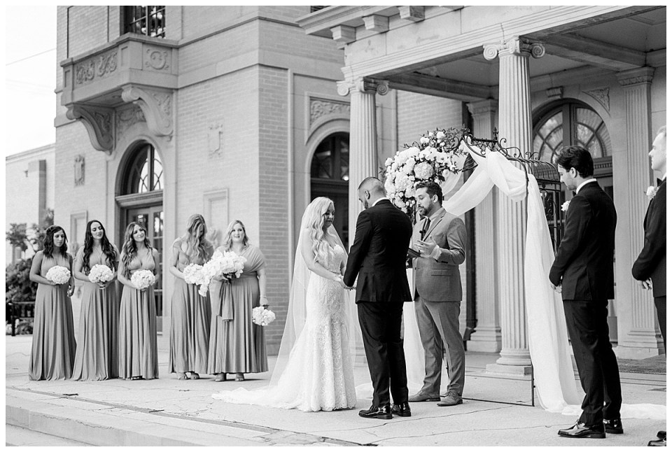 Black and white shot of bride and groom standing at alter| Mansion at Woodward Park wedding| Tulsa wedding| Andi Bravo Photography