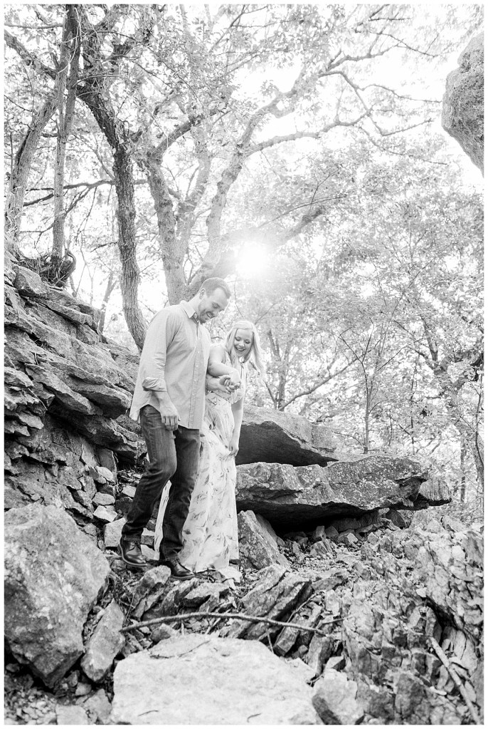Couple hiking down rocks in Chandler Park Tulsa, OK engagement session