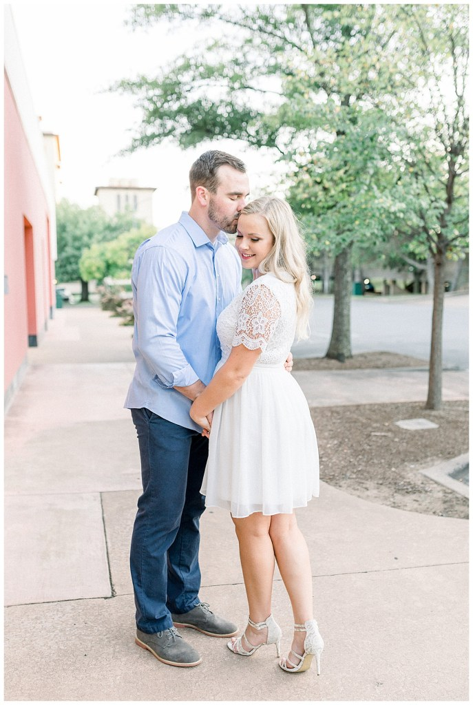 Forehead kisses in Utica Park engagement session, Tulsa OK