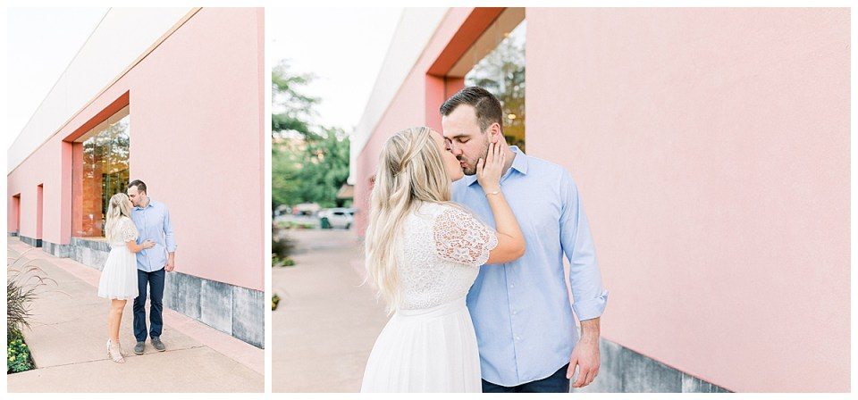 Couple kissing beside pink wall in Utica Square Tulsa engagement session