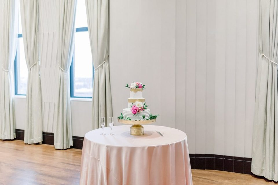 3 tiered pink white and gold cake at Tulsa Club Hotel wedding