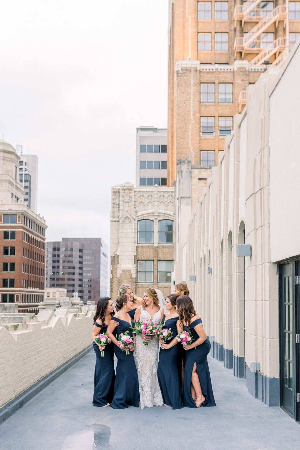 Bride and bridesmaids on rooftop for Tulsa Club Hotel wedding