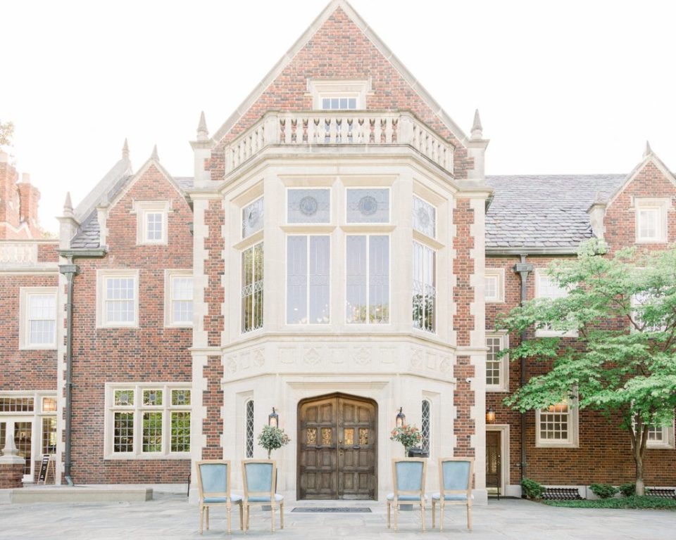 Tulsa Harwelden Mansion with dusty blue vintage chairs in front