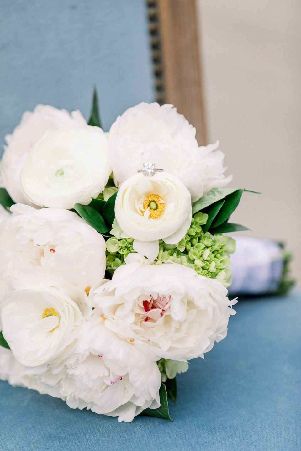 White wedding bouquet with solitaire ring on top