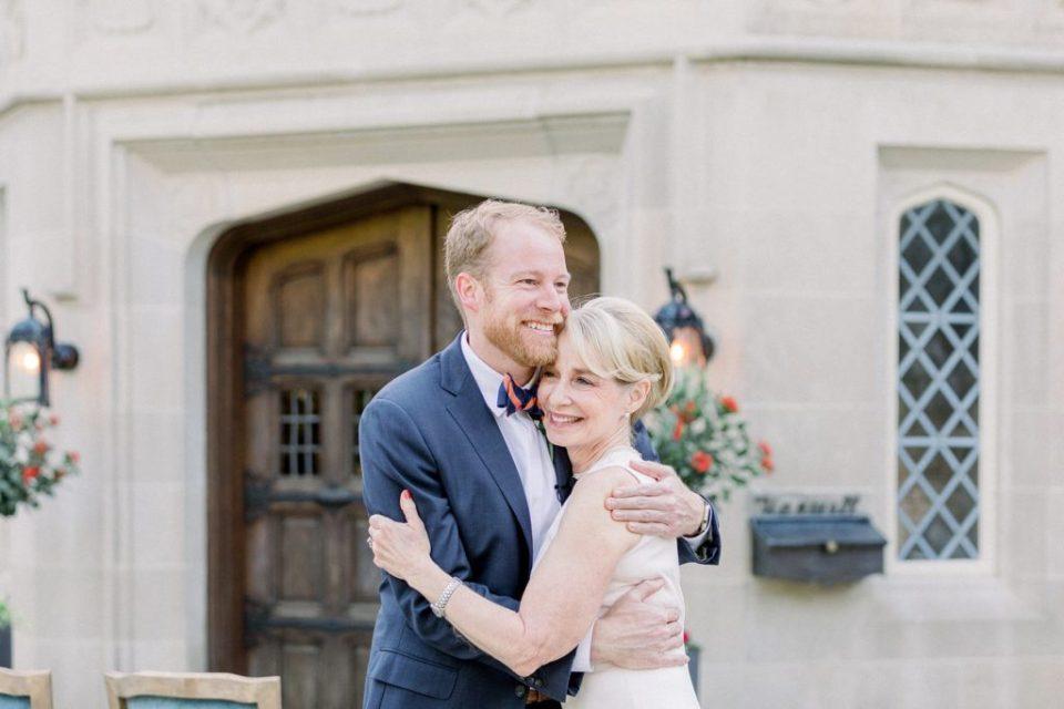 Groom and mother of the groom hug at Harwelden Mansion Tulsa elopement