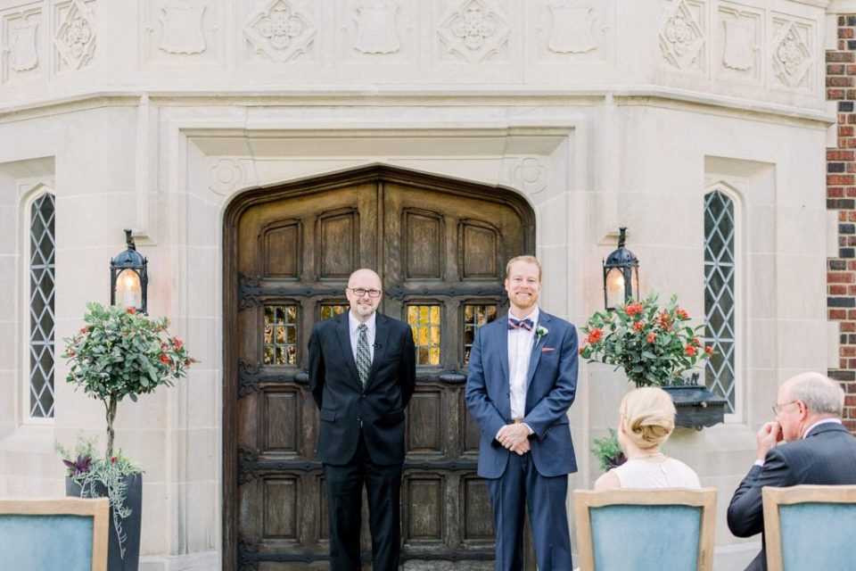 Groom standing at alter next to officiant at Harwelden Mansion Tulsa elopement