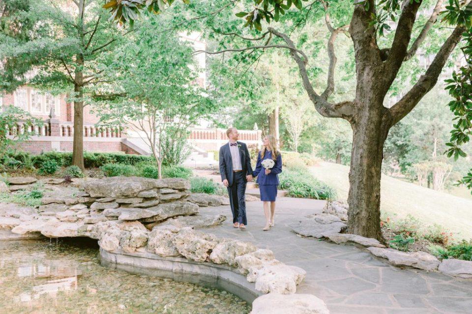 Couple walking through courtyard garden at Tulsa harwelden mansion