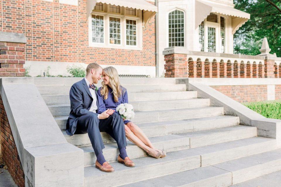 Bride and groom sitting on steps at Harwelden Mansion Tulsa elopement