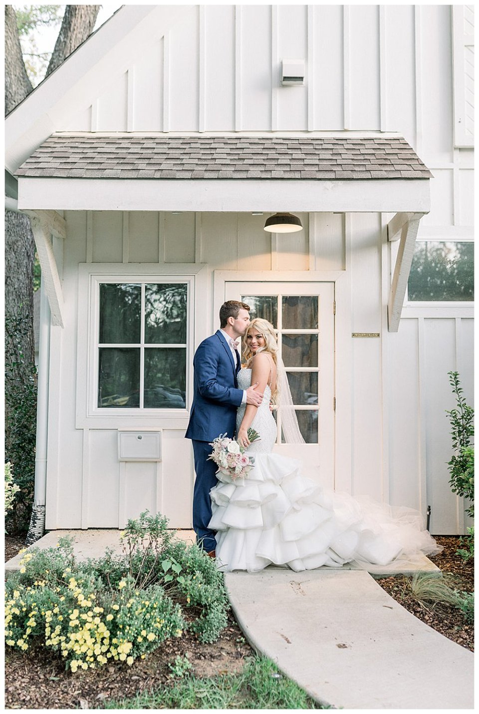 Groom kisses bride on forehead at Spain Ranch